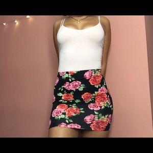 Forever 21 Skirts - Forever 21- Black floral mini skirt XS